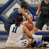 Chloe Brooks wrestles with Nakaila Gray (20) and Faith Funkhouser (22) for a loose ball.  Chloe would receive the fowl from Nakalia