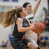 MacKenzie Freeze runs in to the lane for a layup against Lauren Hulvey picking up the fowl along the way