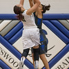 Chloe Brooks blocks a shot by Nakaila Gray