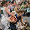 Meredith Vetter muscles her way between Kailey Landis (20) and Destiny Ritchie picking up the foul from Kailey.