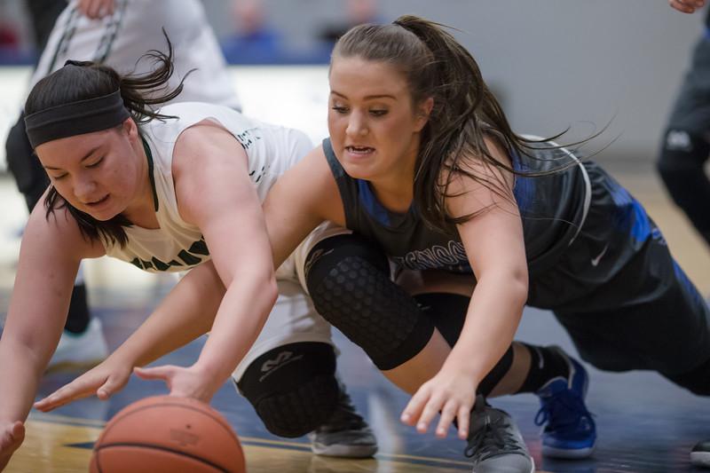 Kaleigh Roadcap and Sarah Wimer both scamble for a loose ball
