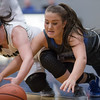Kaleigh Roadcap and Sarah Wimer both scamble for a loose ball