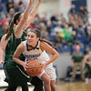 Addison DeLucas takes a look at the basket under Faith Funkhouser.