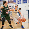 Addison DeLucas brings the ball in past Faith Funkhouser