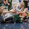 Meredith Vetter, Stephanie Ouderkirk and Faith Funkhouser all battle for a loose ball.