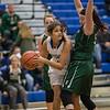 Chloe Brooks looks to pass around Sarah Wimer