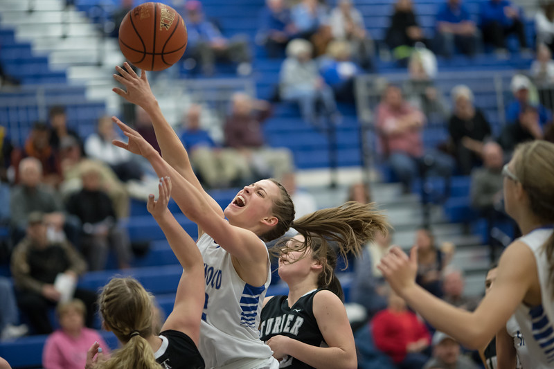 Brooke Vetter goes for a jumpshot in front of the basket as she picks up the fowl from Kylie Heatwole