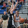 Addison DeLucas prepares to pass the ball to Brooke Vetter under the basket