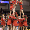 ERHS cheerleaders execute their pyramid during the closing of their routine.