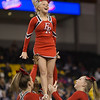 Senior Tori Cook is cradled and brought back down during a stunt