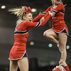 Sophmore Savannah Baugher and Senior Tori Cook turn and look at the crowd during a stunt.
