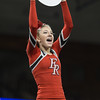 Freshman Madison Swisher holds up a sign during the routine
