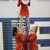 Freshman Madison Swisher is held up by here stunt group