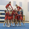 Senior Tori Cook is lifted up to finish ERHS' pyramid.