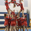 Senior Tori Cook is flipped over during ERHS' pyramid stunt