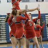 Senior Tori Cook is held up by her stunt group
