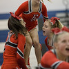 Senior Tori Cook is boosted up by her stunt group.