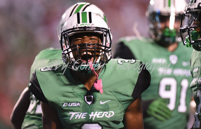 Marshall's Cornelius Sturghill celebrates after an interception on Saturday evening against Louisville.  MARTY CONLEY/ FOR THE DAILY INDEPENDENT