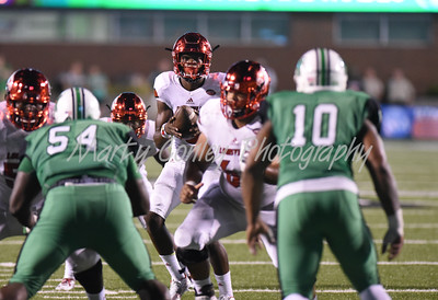 Louisville quarterback, Lamar Jackson takes a snap against Marshall on Saturday evening in Huntington, WV.  MARTY CONLEY/ FOR THE DAILY INDEPENDENT