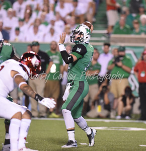 Marshall quarterback, Garet Morrell attempts a pass against Louisville on Saturday evening.  MARTY CONLEY/ FOR THE DAILY INDEPENDENT