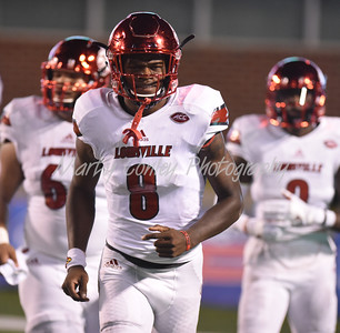 Louisville quarterback, Lamar Jackson runs to the sidelines after throwing a touchdown against Marshall on Saturday evening.  MARTY CONLEY/ FOR THE DAILY INDEPENDENT