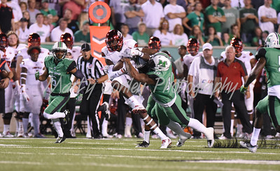 Louisville's Jamari Staples pulls in a pass as Marshall's Devontre'a Tyler goes for the tackle on Saturday evening.  MARTY CONLEY/ FOR THE DAILY INDEPENDENT