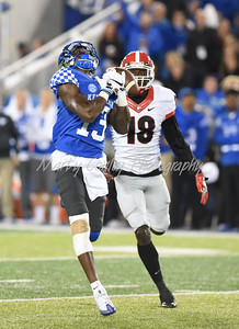 Kentucky's Jeff Badet mishandles a reception that lead to an interception by Georgia's Deandre Baker on Saturday evening.  MARTY CONLEY/ FOR THE DAILY INDEPENDENT