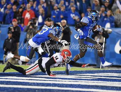 Boom Williams of Kentucky makes it into the endzone past Georgia's Malkom Parrish on Saturday.  MARTY CONLEY/ FOR THE DAILY INDEPENDENT