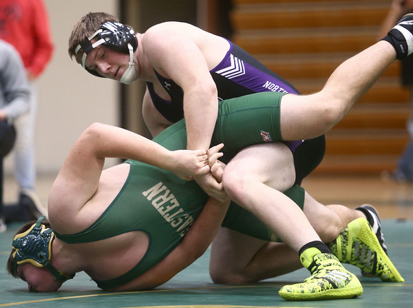 12-29-16<br /> Eastern vs Northwestern wrestling<br /> Northwestern's Max Clark defeats Eastern's Ryan Keller in the 220.<br /> Kelly Lafferty Gerber | Kokomo Tribune