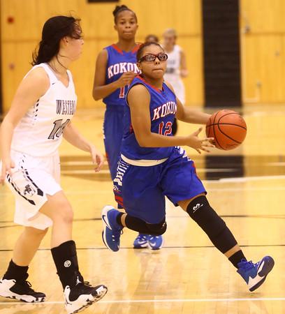 12-6-16<br /> Kokomo vs Western girls basketball<br /> Kokomo's Tevin Deckard moves down the court.<br /> Kelly Lafferty Gerber | Kokomo Tribune