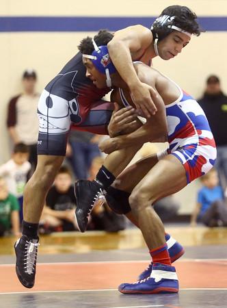 12-13-16<br /> Kokomo vs Logansport wrestling<br /> Kokomo's Jabin Wright defeats Logansport's Jesse Dominguez in the 126.<br /> Kelly Lafferty Gerber   Kokomo Tribune