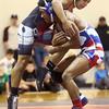 12-13-16<br /> Kokomo vs Logansport wrestling<br /> Kokomo's Jabin Wright defeats Logansport's Jesse Dominguez in the 126.<br /> Kelly Lafferty Gerber | Kokomo Tribune