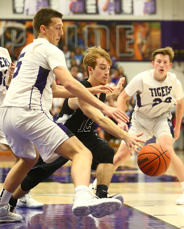 12-2-16<br /> Northwestern vs Western boys basketball<br /> Western's Cooper O'Neal and Northwestern's Jay Pike go after a loose ball.<br /> Kelly Lafferty Gerber | Kokomo Tribune
