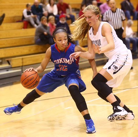 12-6-16<br /> Kokomo vs Western girls basketball<br /> Jayda Andrews dribbles around Western's defense.<br /> Kelly Lafferty Gerber   Kokomo Tribune