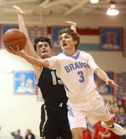 12-29-16<br /> Maconaquah vs Peru boys basketball<br /> Maconaquah's Chandler Pitts leaps to the basket.<br /> Kelly Lafferty Gerber | Kokomo Tribune