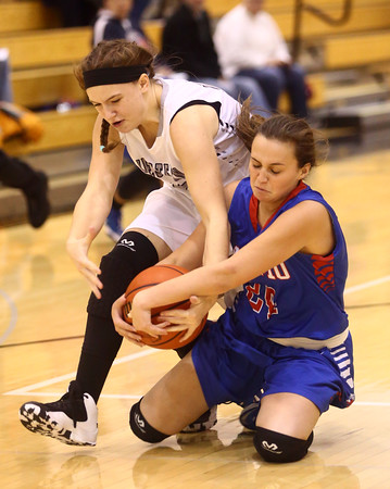 12-6-16<br /> Kokomo vs Western girls basketball<br /> Western's Sophia Wright and Kokomo's Olivia Branch battle over a loose ball.<br /> Kelly Lafferty Gerber | Kokomo Tribune