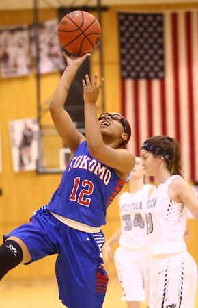 12-6-16<br /> Kokomo vs Western girls basketball<br /> Kokomo's Tevin Deckard shoots.<br /> Kelly Lafferty Gerber | Kokomo Tribune