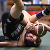 12-29-16<br /> Eastern vs Northwestern wrestling<br /> Eastern's Tytus Morrisett defeats Northwestern's Tanner Pipenger in the 126.<br /> Kelly Lafferty Gerber | Kokomo Tribune