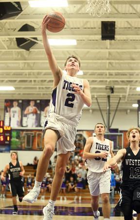 12-2-16<br /> Northwestern vs Western boys basketball<br /> Northwestern's Collin Hodson goes to the basket.<br /> Kelly Lafferty Gerber | Kokomo Tribune