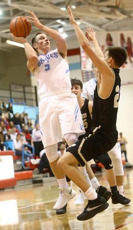 12-29-16<br /> Maconaquah vs Peru boys basketball<br /> Maconaquah's Ethan Larason shoots.<br /> Kelly Lafferty Gerber   Kokomo Tribune