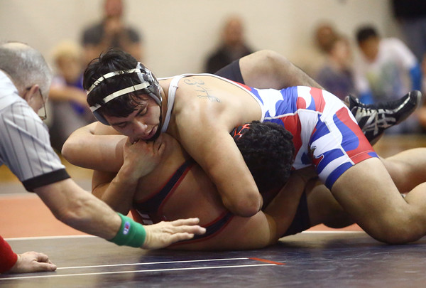 12-13-16<br /> Kokomo vs Logansport wrestling<br /> Kokomo's Gavin Herrera defeats Logansport's Michael Salinas in the 195.<br /> Kelly Lafferty Gerber   Kokomo Tribune