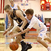 12-29-16<br /> Maconaquah vs Peru boys basketball<br /> Peru's Jonah Lester and Maconaquah's Chandler Pitts go after a loose ball.<br /> Kelly Lafferty Gerber | Kokomo Tribune