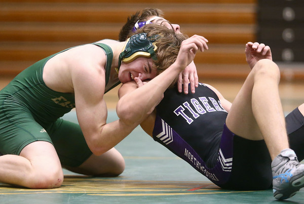 12-29-16<br /> Eastern vs Northwestern wrestling<br /> Eastern's Austin Duchateau defeats Northwestern's Mason Coen in the 132.<br /> Kelly Lafferty Gerber | Kokomo Tribune