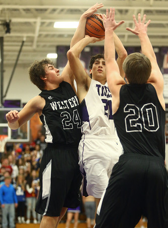 12-2-16<br /> Northwestern vs Western boys basketball<br /> Thomas Crocker goes up for a shot between Western's defense.<br /> Kelly Lafferty Gerber | Kokomo Tribune
