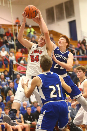 12-16-16<br /> Cass vs Tipton boys basketball<br /> Cass' Cohen Nies and Tipton's Luke Stoker go after a rebound.<br /> Kelly Lafferty Gerber | Kokomo Tribune