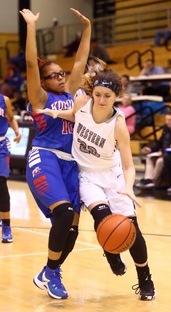 12-6-16<br /> Kokomo vs Western girls basketball<br /> Western's Livi King tries to get around Kokomo's defense.<br /> Kelly Lafferty Gerber | Kokomo Tribune