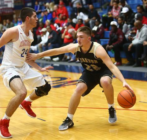 12-3-16<br /> Kokomo vs Lebanon boys basketball<br /> Lebanon's Clayton Barber looks to get around Kokomo's defense.<br /> Kelly Lafferty Gerber | Kokomo Tribune