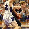 12-2-16<br /> Northwestern vs Western boys basketball<br /> Cooper O'Neal looks to get around Northwestern's defense.<br /> Kelly Lafferty Gerber | Kokomo Tribune