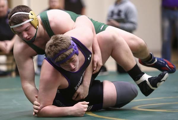 12-29-16<br /> Eastern vs Northwestern wrestling<br /> Eastern's Evan Ellis defeats Northwestern's Colten Pipenger in the heavyweight.<br /> Kelly Lafferty Gerber | Kokomo Tribune