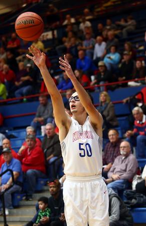 12-3-16<br /> Kokomo vs Lebanon boys basketball<br /> Kokomo's Nate Hemmerich shoots a three.<br /> Kelly Lafferty Gerber | Kokomo Tribune